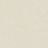 Seamless washy sandy grainy plain light beige paper texture background
