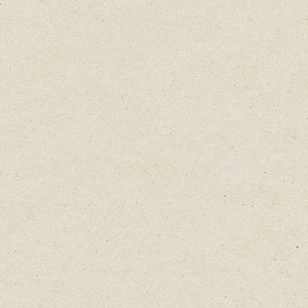 Seamless washy sandy grainy plain light beige paper texture background stock photo