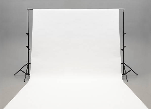 seamless white background paper hanging on stands-isolated on grey - 摄影 個照片及圖片檔