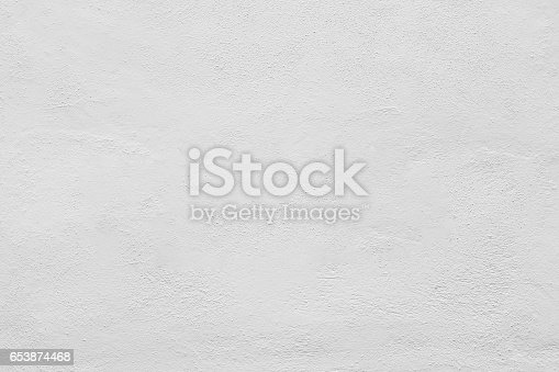 istock Seamless white painted concrete wall texture - background 653874468