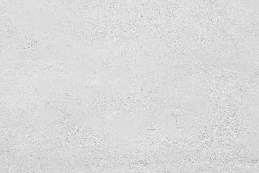 Seamless white painted concrete wall texture - background