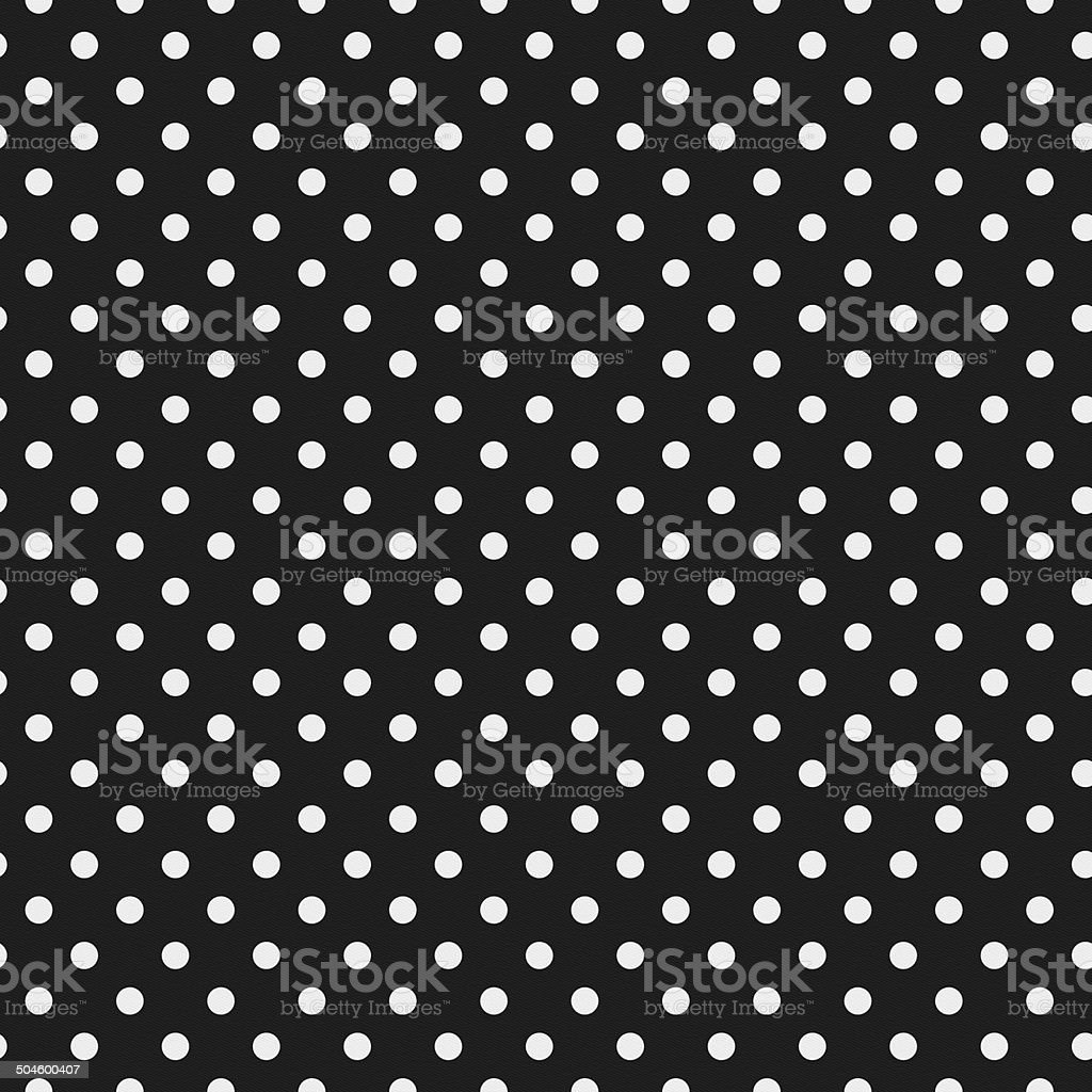 Seamless white polka dot pattern on black paper stock photo