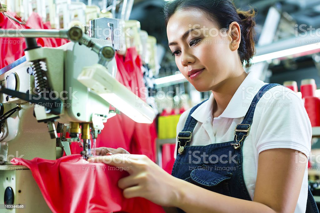 Seamstress in a chinese textile factory stock photo