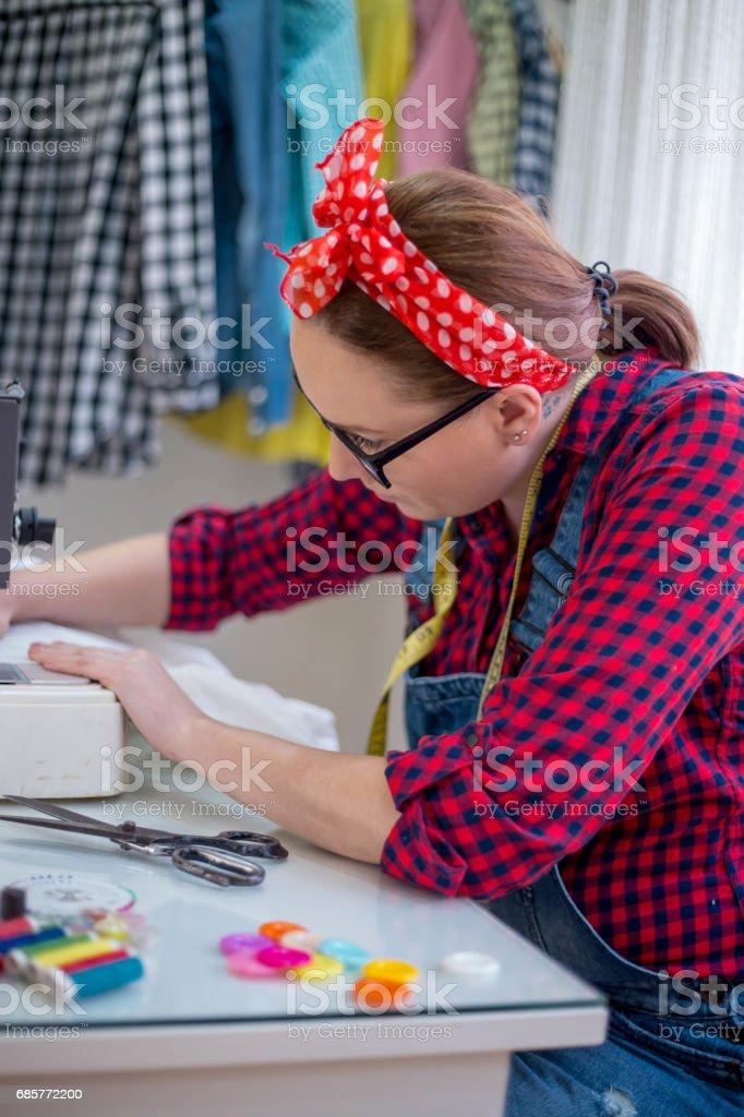 Seamstress woman preparing material royalty-free stock photo