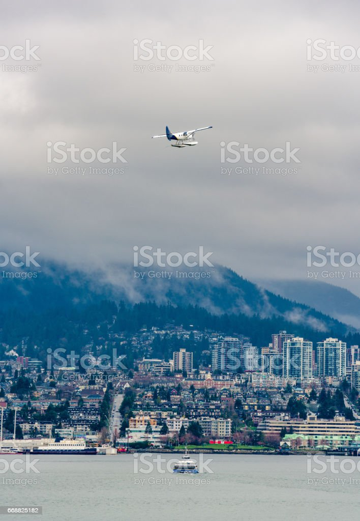 Seaplane and ferry to the North Vancouver stock photo