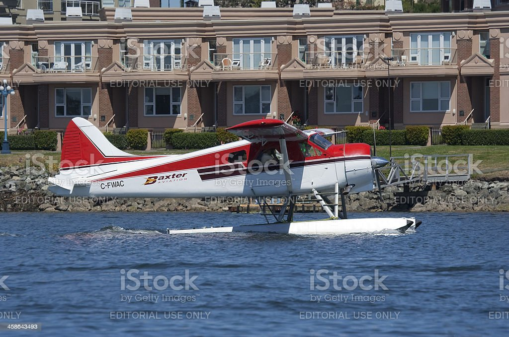 Seaplane landing in front of Tourist Resort royalty-free stock photo