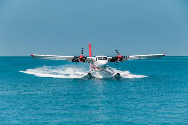 Seaplane landing in Maldives lagoon