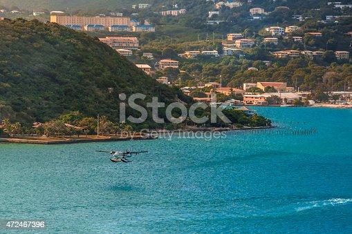A seaplane taking off over Charlotte Amalie Harbor, US Virgin Islands.