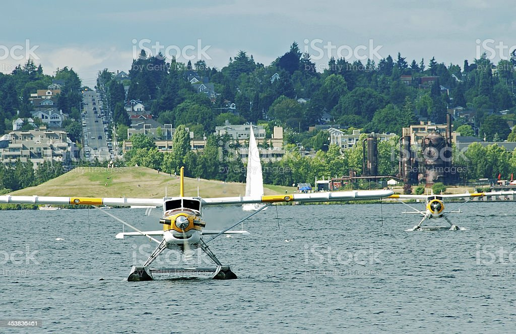 Seaplanes landing on lake in Seattle WA stock photo