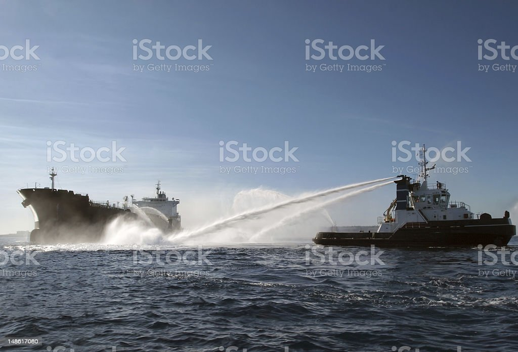 Search and rescue: Fireboat in action stock photo
