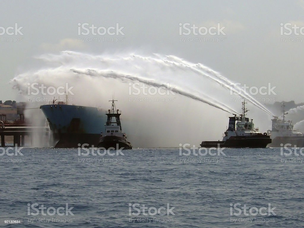 Search and rescue: Fireboats in action, oil tanker on fire stock photo
