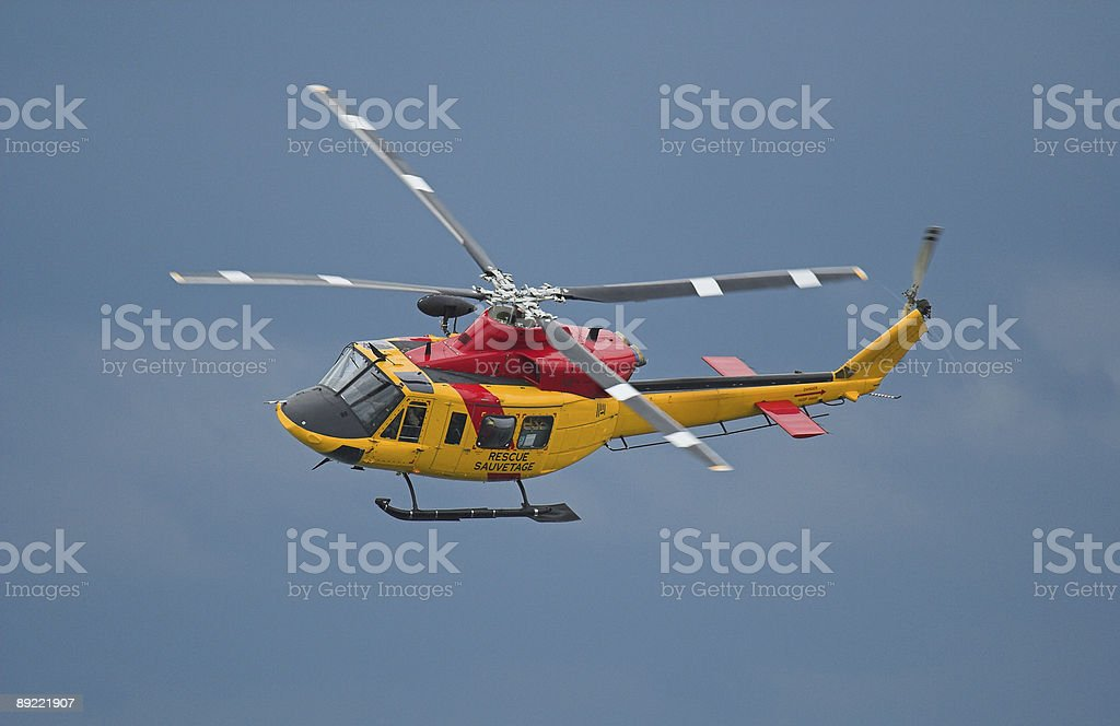 A search and rescue helicopter flying through the sky  stock photo