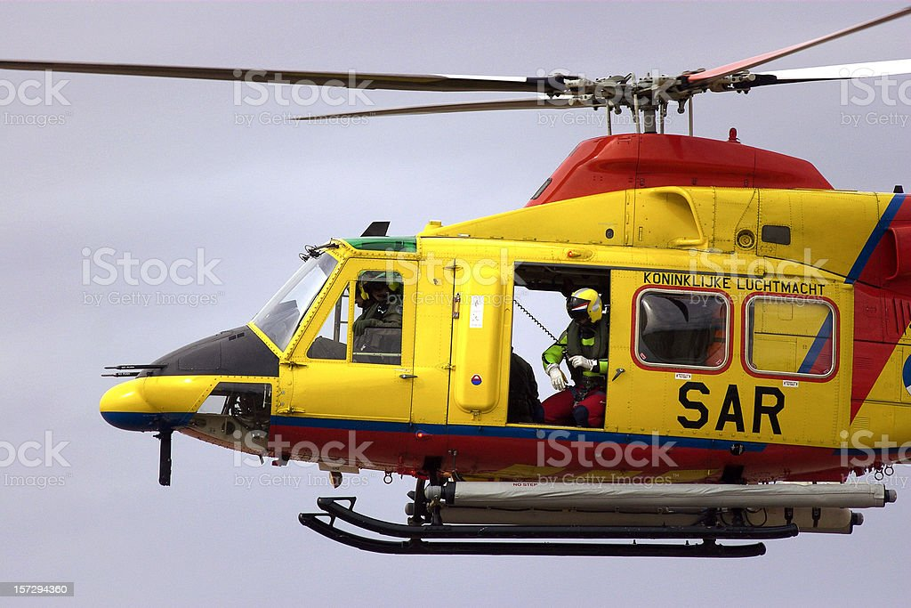 Search and Rescue Helicopter with winch man royalty-free stock photo