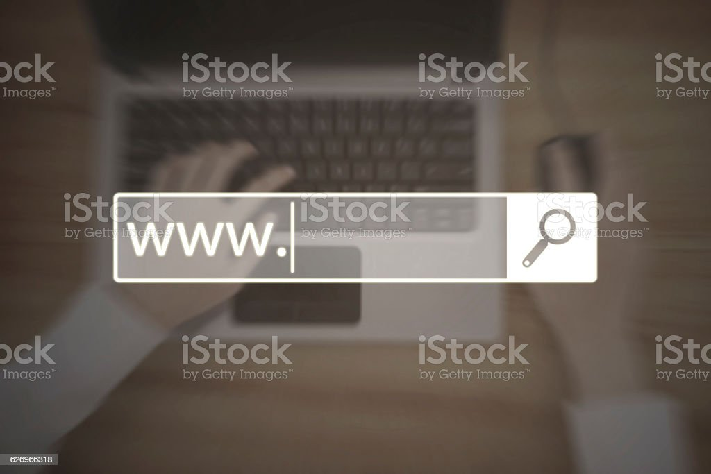 Search bar with www text and laptop stock photo