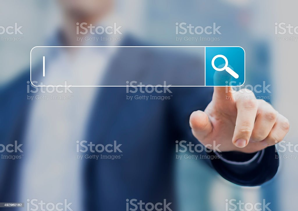Search button on virtual screen pressed with finger stock photo