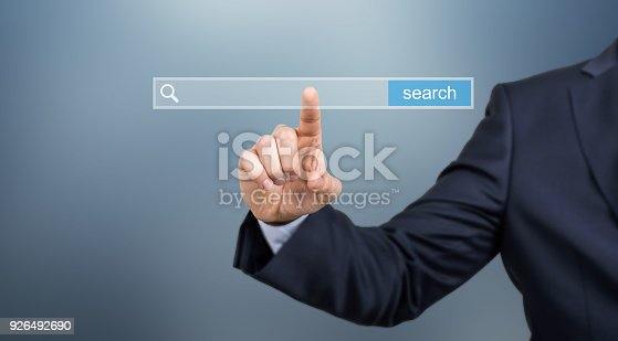 492960182 istock photo Search button on virtual screen pressed with finger 926492690