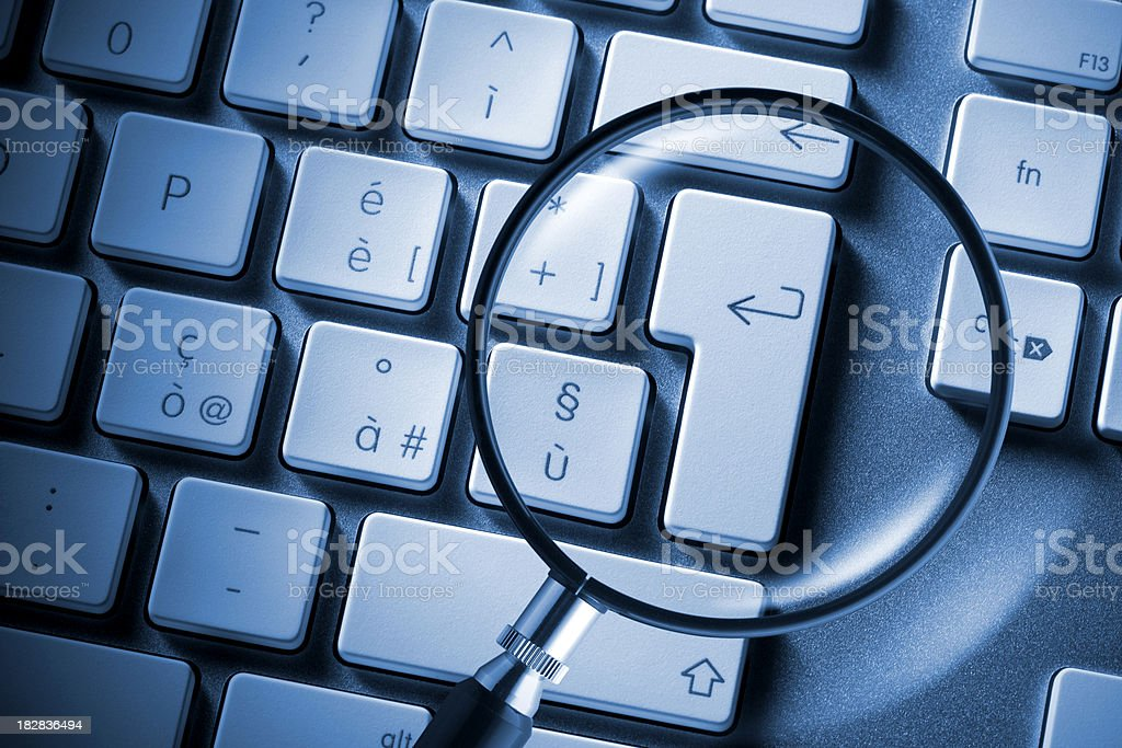 Search. Computer keyboard with magnifying glass. stock photo