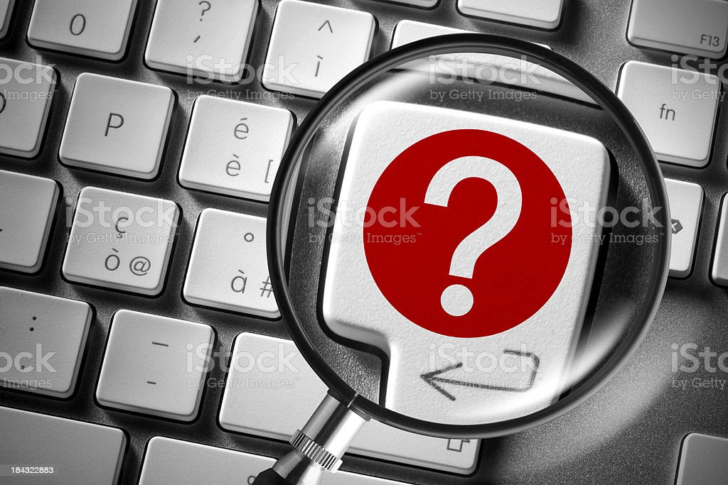 Search. Computer keyboard with question mark enlarged by magnifying glass royalty-free stock photo