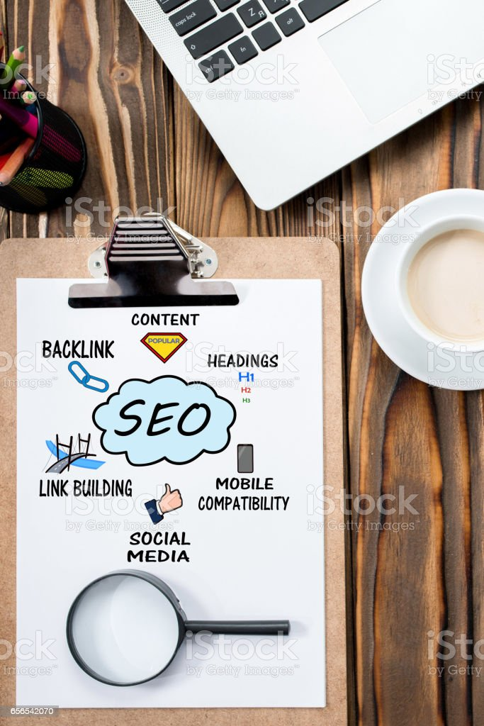 Search Engine Optimization (SEO) Concept On Work Desk stock photo