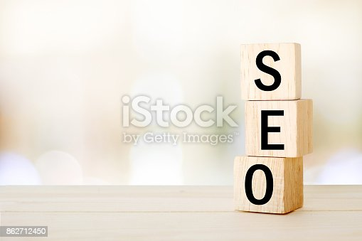 istock SEO, search engine optimization, on wooden cubes and blur bokeh background, business concept, digital marketing 862712450