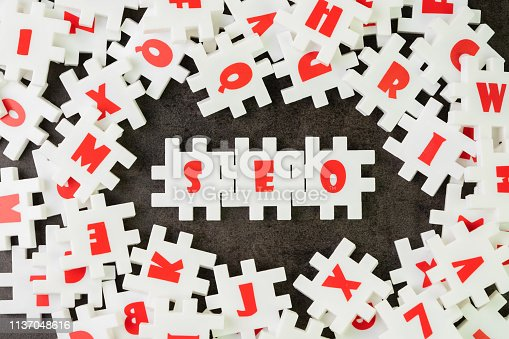 1045434476istockphoto Search Engine Optimization, SEO concept, white puzzle jigsaw with alphabet building the word SEO at the center of dark chalkboard 1137048616