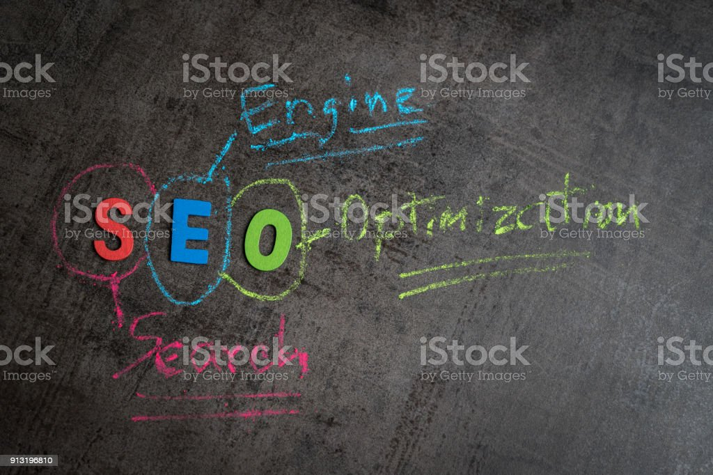 Search engine optimization, SEO ranking concept as colorful alphabet SEO, hand write explanation with color chalk on chalkboard wall, important of keyword management for website traffic promotion stock photo