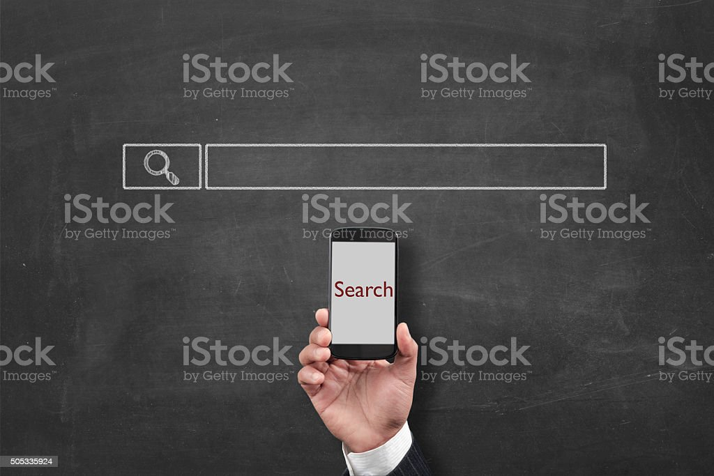 Search engine optimization with smartphone stock photo