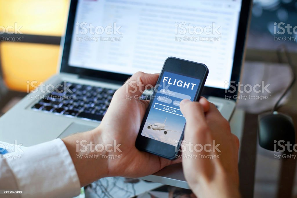 search flights on mobile application online, booking of plane tickets stock photo