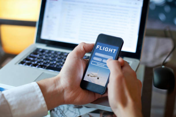 search flights on mobile application online, booking of plane tickets search flights on mobile application online, booking of plane tickets, travel planning concept making a reservation stock pictures, royalty-free photos & images