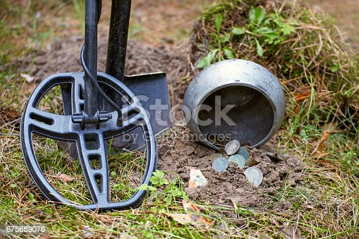 istock Search for treasure using a metal detector and shovel. 675659076