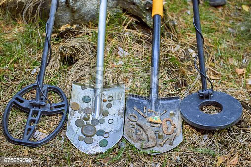 istock Search for treasure using a metal detector and shovel. 675659090