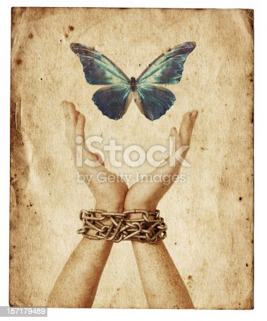 Chained hands reaching for a butterfly.  On old paper.