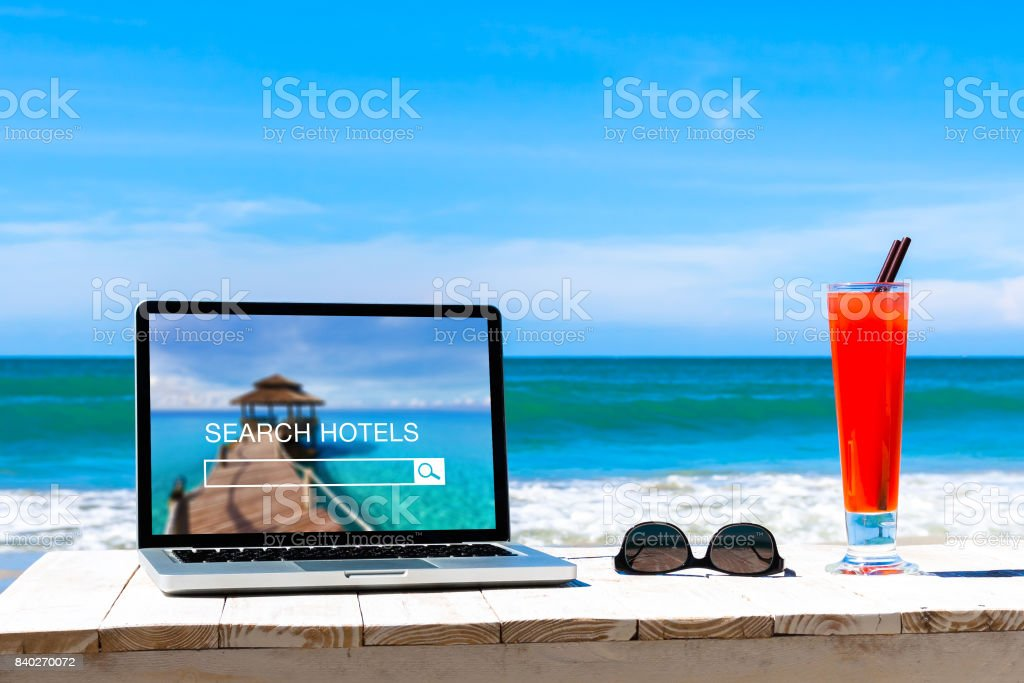 Search hotels website on computer screen, online booking concept stock photo