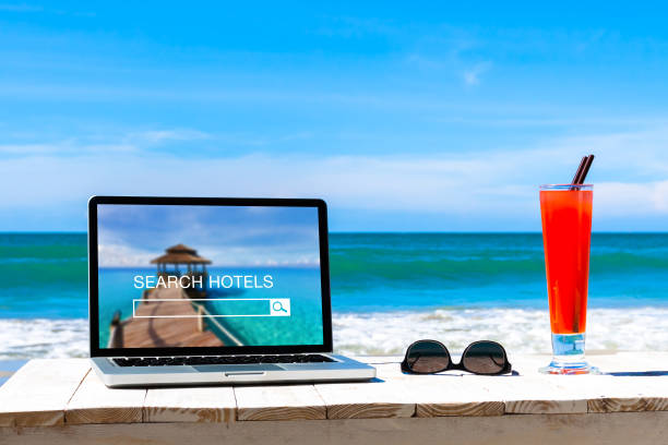 Search hotels website on computer screen, online booking concept - foto stock