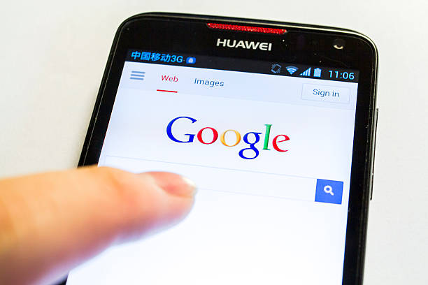 Search with Google Shanghai, China - Apr 30, 2013: Man searching Google with a Huawei Ascend D1 Qual XL cellphone. Huawei, originated in China, is now a leading global ICT solutions provider. The search engine is powered by Google, an American multinational corporation that provides Internet-related products and services, including internet search, cloud computing, software and advertising technologies.  huawei stock pictures, royalty-free photos & images