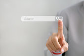 istock Searching Browsing Internet Data Information Networking Concept,Business man clicking internet search page on computer touch screen,copy space. 1141748040