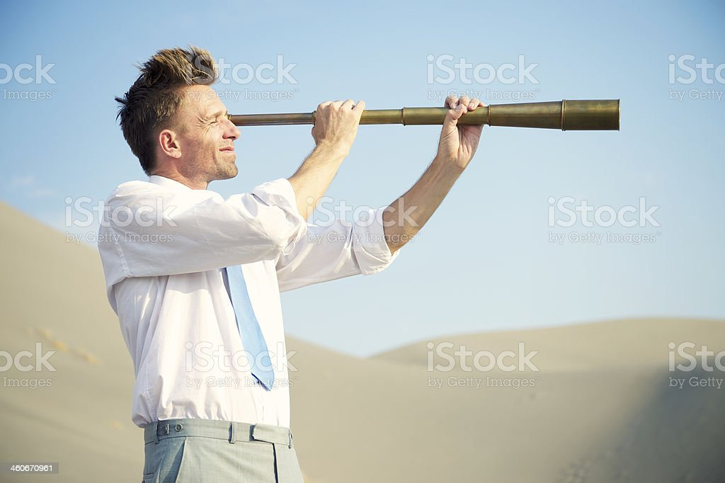 Searching Businessman Holding Telescope Desert Landscape stock photo