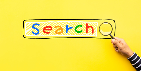 istock Searching concepts with male hand using magnifying glass with Search text icon on yellow space background 1161422704