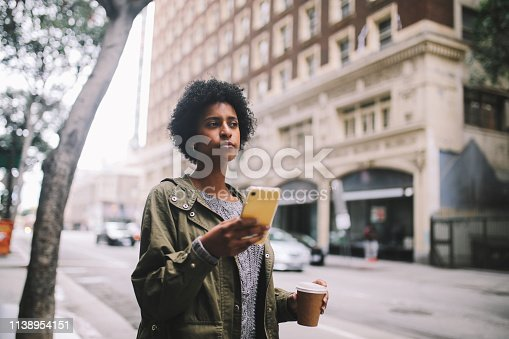 istock searching for a taxi in downtown Los Angeles 1138954151
