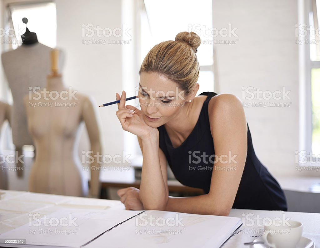 Searching for her fashion muse... stock photo