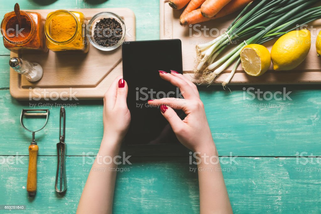 Searching for recipe on a tablet stock photo