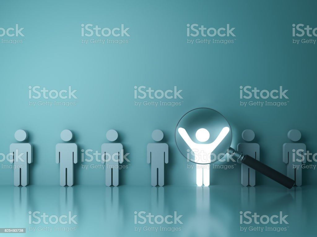 Searching for the right person concept, Stand out from the crowd and different concept , Magnifying glass focusing on the light man standing with arms wide open on green wall background. 3D rendering stock photo