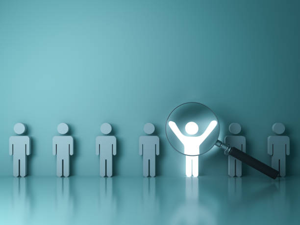 searching for the right person concept, stand out from the crowd and different concept , magnifying glass focusing on the light man standing with arms wide open on green wall background. 3d rendering - identity stock photos and pictures