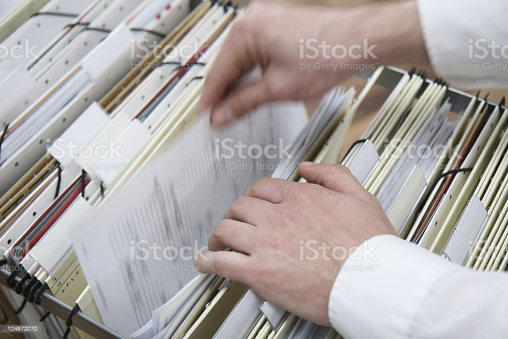 searching in a file cabinet stock photo