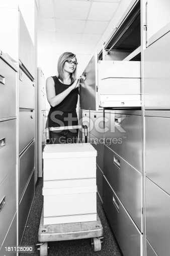 535191355istockphoto Searching in filing cabinets 181128090