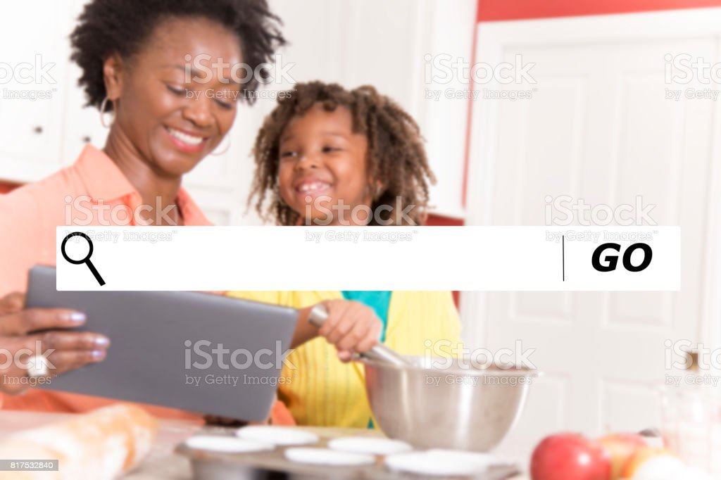 Searching internet websites for baking recipes. stock photo