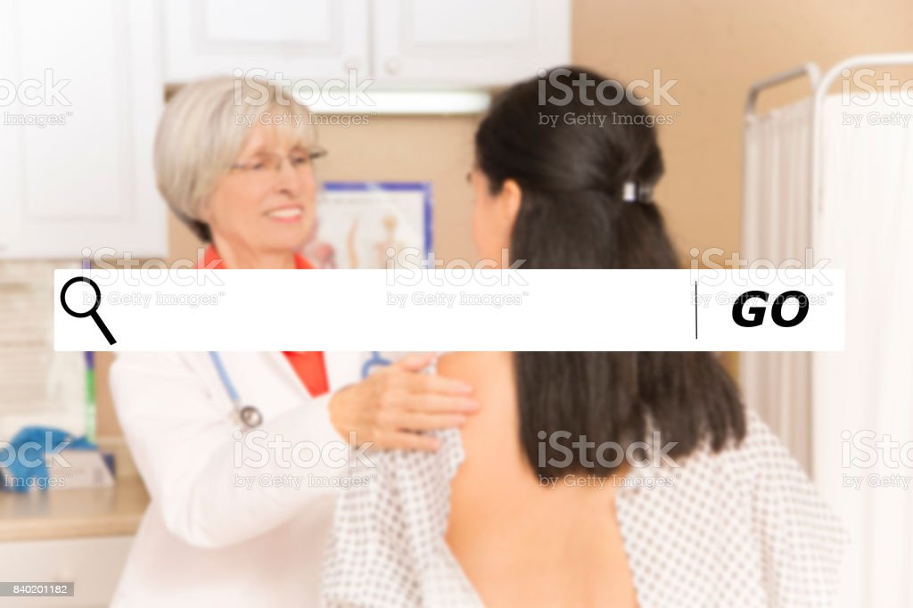 Searching internet websites for gynecologist doctors. stock photo