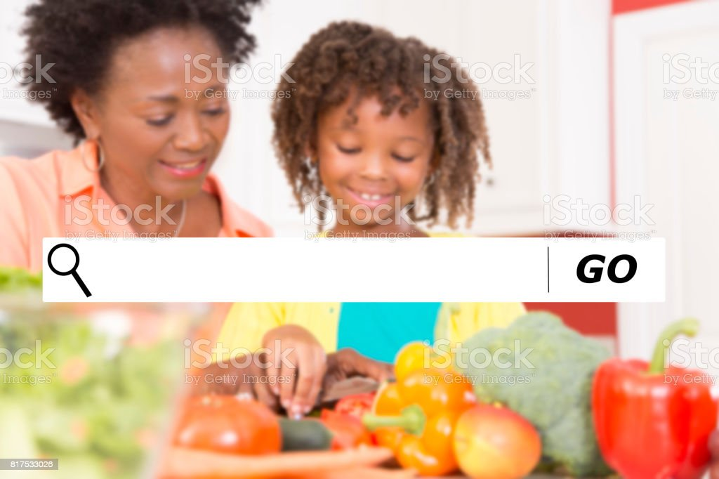 Searching internet websites for healthy family recipes. stock photo