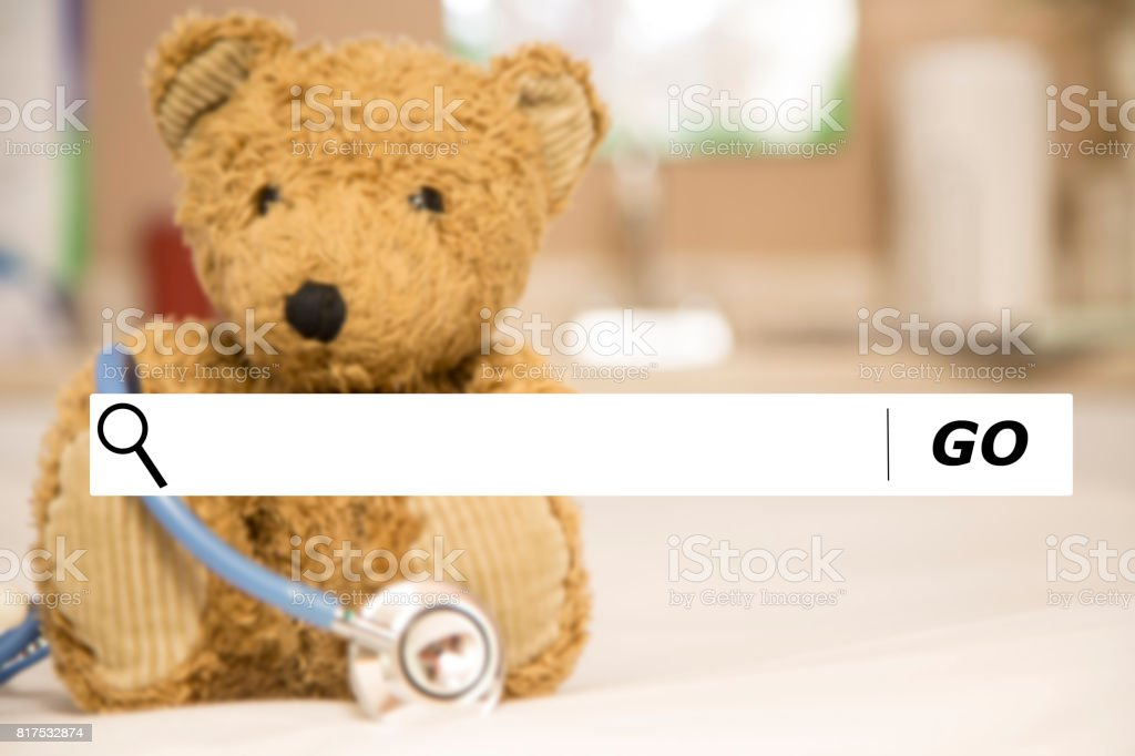 Searching internet websites for pediatrician doctors. stock photo