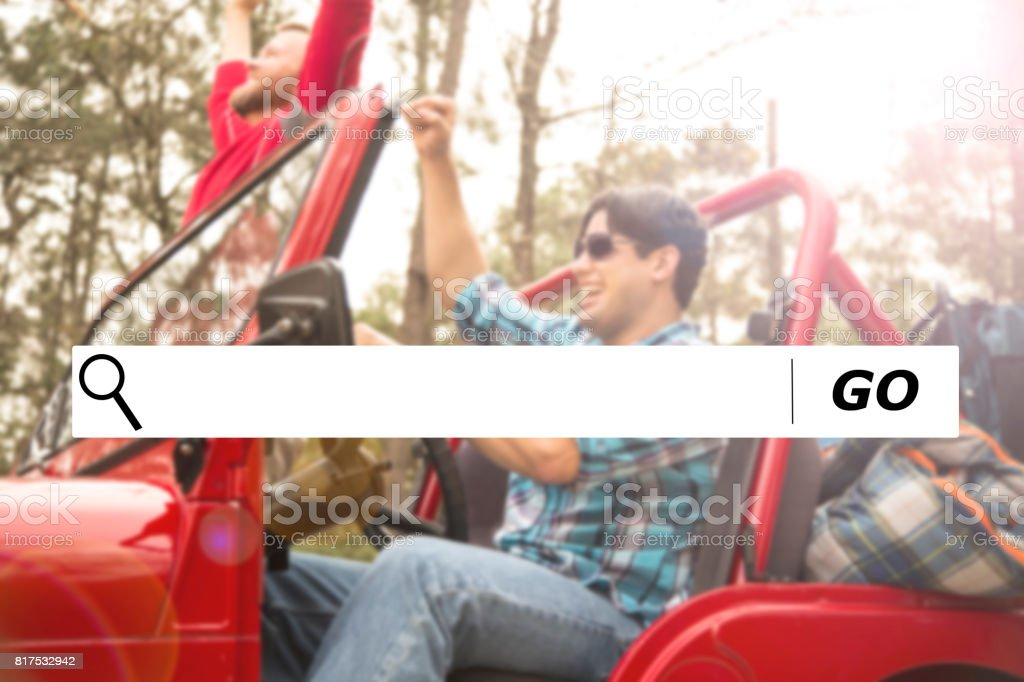 Searching internet websites for road trip destinations. stock photo